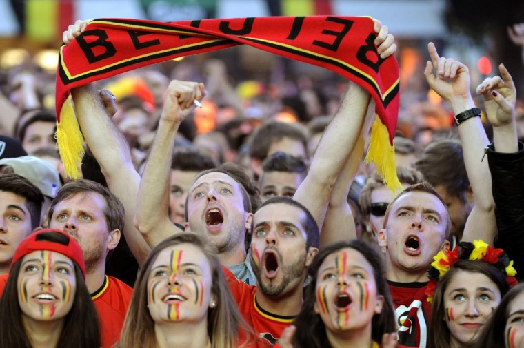 Belgium supporters react during the Brazil World Cup Group H soccer match against the U.S., at Saint Job place in Brussels July 1, 2014. (Eric Vidal/Reuters)