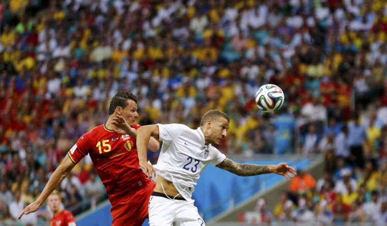 Belgium's Daniel Van Buyten fights for the ball with Fabian Johnson of the U.S. during their 2014 World Cup round of 16 game at the Fonte Nova arena in Salvador July 1, 2014.(Marcos Brindicci/Reuters)