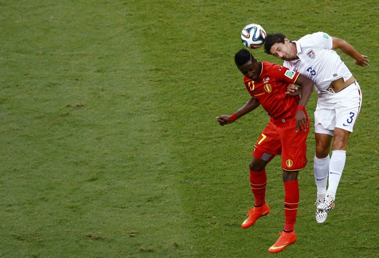 Belgium's Divock Origi heads the ball beside Omar Gonzalez of the U.S. (R) during their 2014 World Cup round of 16 game at the Fonte Nova arena in Salvador July 1, 2014. (Ruben Sprich/Reuters)