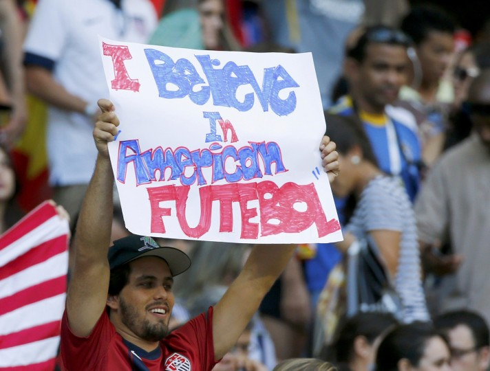 A U.S. fan holds up a sign before the 2014 World Cup round of 16 game between Belgium and the U.S. at the Fonte Nova arena in Salvador July 1, 2014. (Michael Dalder/Reuters)