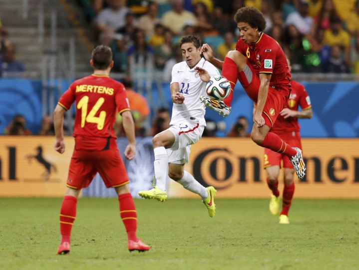 Belgium's Dries Mertens (14) watches Alejandro Bedoya of the U.S. fight for the ball with Axel Witsel during the 2014 World Cup round of 16 game between Belgium and the U.S. at the Fonte Nova arena in Salvador July 1, 2014. (Marcos Brindicci/Reuters)