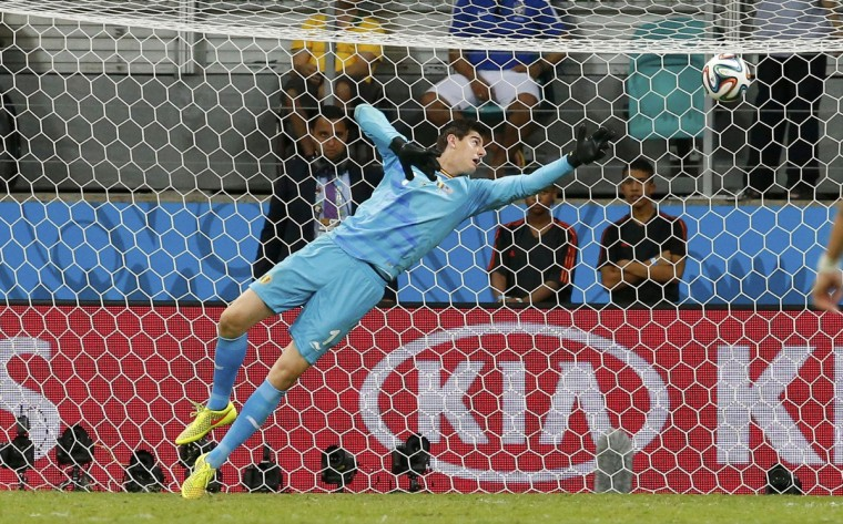Belgium's goalkeeper Thibaut Courtois fails to save a ball during the 2014 World Cup round of 16 game between U.S. and Belgium at the Fonte Nova arena in Salvador July 1, 2014. (Yves Herman/Reuters)