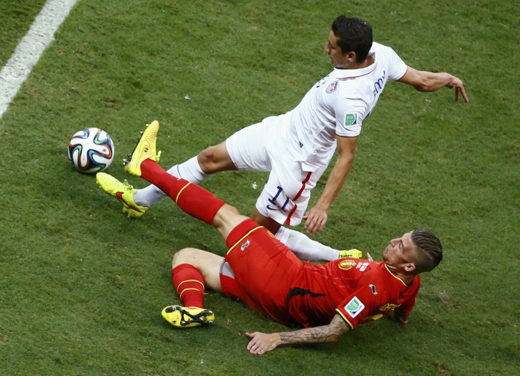 Alejandro Bedoya of the U.S. (back) fights for the ball with Belgium's Toby Alderweireld during their 2014 World Cup round of 16 game at the Fonte Nova arena in Salvador July 1, 2014. (Ruben Sprich/Reuters)