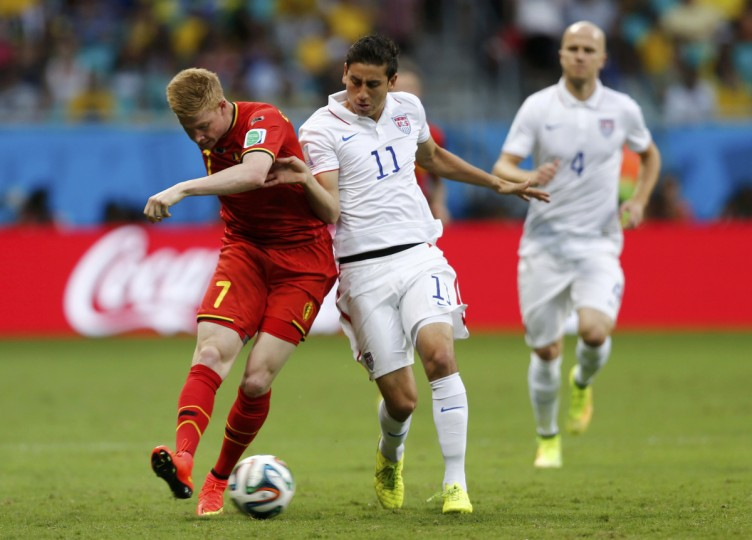 Belgium's Kevin De Bruyne (L) fights for the ball with Alejandro Bedoya of the U.S. during their 2014 World Cup round of 16 game at the Fonte Nova arena in Salvador July 1, 2014. (Marcos Brindicci/Reuters)