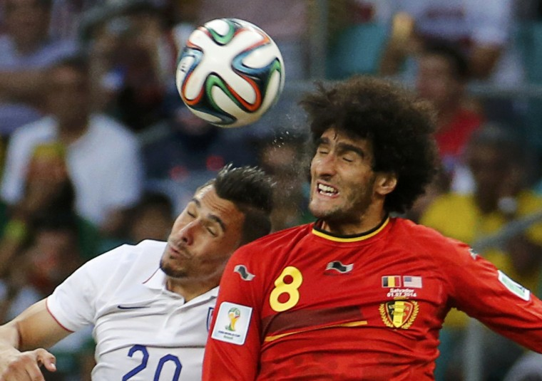 Geoff Cameron of the U.S. jumps for the ball with Belgium's Marouane Fellaini during their 2014 World Cup round of 16 game at the Fonte Nova arena in Salvador July 1, 2014. (Sergio Moraes/Reuters)