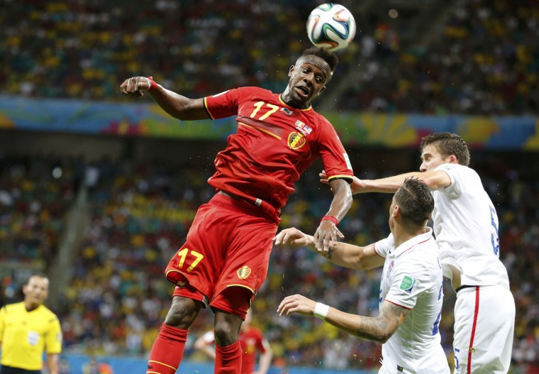 Belgium's Divock Origi jumps for the ball next to Geoff Cameron and Matt Besler (R) of the U.S. during their 2014 World Cup round of 16 game at the Fonte Nova arena in Salvador July 1, 2014. (Sergio Moraes/Reuters)