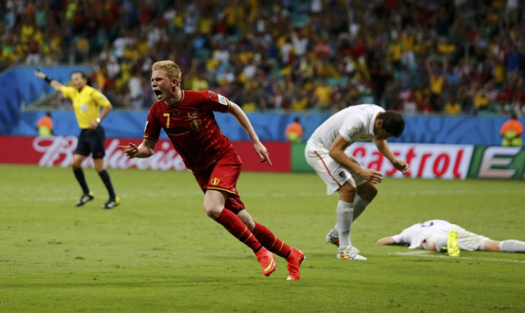 Belgium's Kevin De Bruyne (L) celebrates after scoring against the U.S. in extra time during their 2014 World Cup round of 16 game at the Fonte Nova arena in Salvador July 1, 2014. (Marcos Brindicci/Reuters)