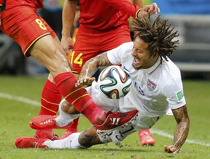 Belgium's Marouane Fellaini kicks the ball near Jermaine Jones of the U.S. during their 2014 World Cup round of 16 game at the Fonte Nova arena in Salvador July 1, 2014. (Yves Herman/Reuters)