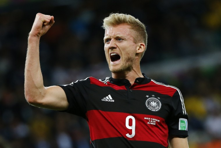Germany's Andre Schuerrle celebrates scoring his team's sixth goal against Brazil during their 2014 World Cup semi-finals at the Mineirao stadium in Belo Horizonte July 8, 2014. (Damir Sagolj/Reuters)