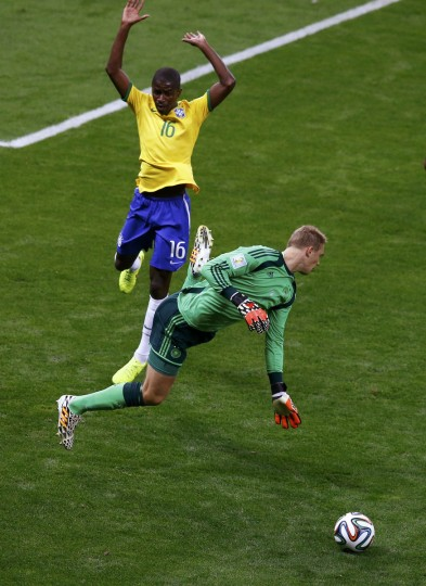 Germany's goalkeeper Manuel Neuer fights for the ball with Brazil's Ramires during their 2014 World Cup semi-finals at the Mineirao stadium in Belo Horizonte July 8, 2014. (Leonhard Foeger/Reuters)