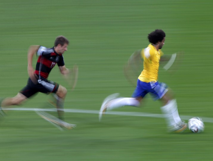 Germany's Thomas Mueller (L) and Brazil's Marcelo chase the ball during their 2014 World Cup semi-finals at the Mineirao stadium in Belo Horizonte July 8, 2014. (David Gray/Reuters)