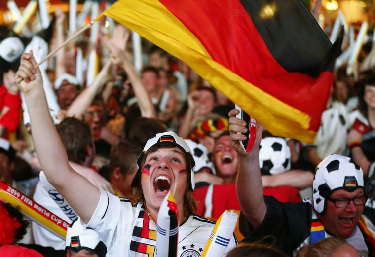 People celebrate after Germany scored against Brazil during their 2014 World Cup semi-finals, at the Fanmeile public viewing arena in Berlin July 8, 2014. (Thomas Peter/Reuters)