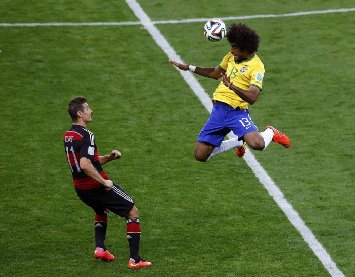 Brazil's Dante jumps for the ball in front of Germany's Miroslav Klose during their 2014 World Cup semi-finals at the Mineirao stadium in Belo Horizonte July 8, 2014. (Leonhard Foeger/Reuters)
