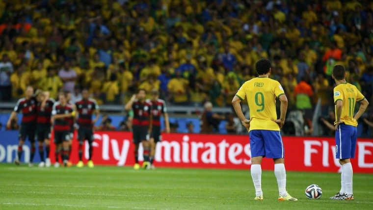 Brazil's Fred (2nd R) and Oscar (R) react after Germany scored its third goal during their 2014 World Cup semi-finals at the Mineirao stadium in Belo Horizonte July 8, 2014. (Damir Sagolj/Reuters)