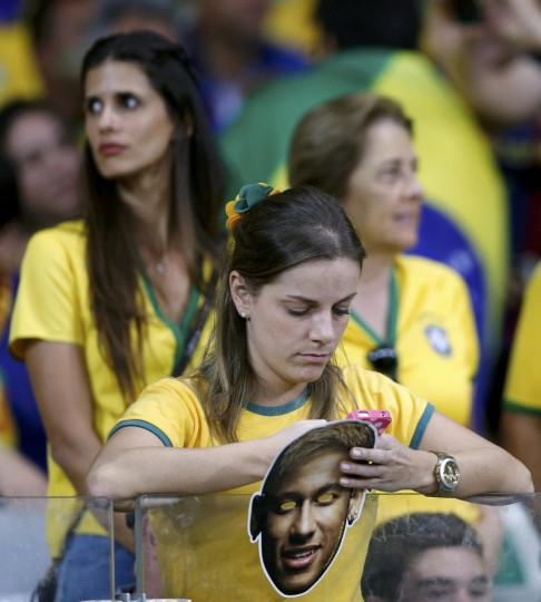 A fan holds a mask of Brazil's Neymar during the 2014 World Cup semi-finals between Brazil and Germany at the Mineirao stadium in Belo Horizonte July 8, 2014. (Marcos Brindicci/Reuters)