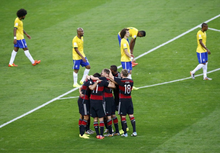 Germany's Sami Khedira celebrates with temamates scoring against Brazil during their 2014 World Cup semi-finals at the Mineirao stadium in Belo Horizonte July 8, 2014. (Leonhard Foeger/Reuters)