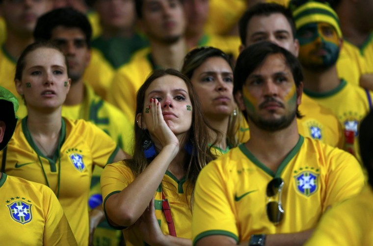 Brazil fans react during the 2014 World Cup semi-finals between Brazil and Germany at the Mineirao stadium in Belo Horizonte July 8, 2014. (Eddie Keogh/Reuters)