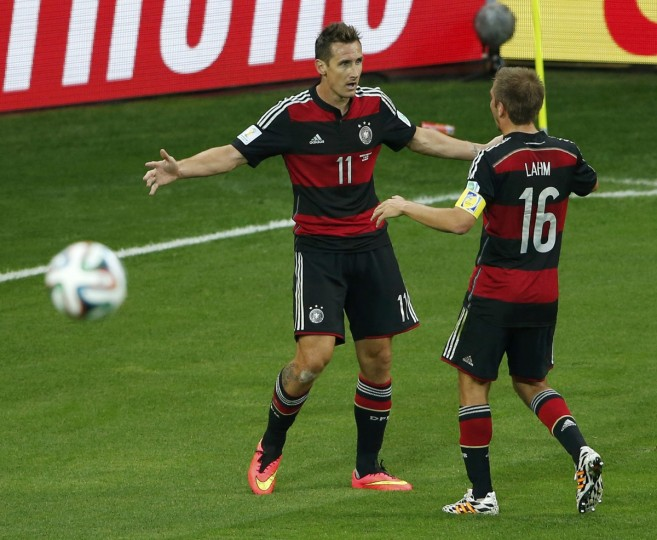 Germany's Miroslav Klose (L) celebrates with his teammate Philipp Lahm after scoring his team's second goal against Brazil during their 2014 World Cup semi-finals at the Mineirao stadium in Belo Horizonte July 8, 2014. (David Gray/Reuters)