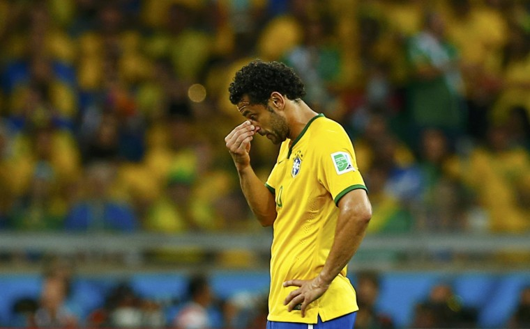 Brazil's Fred reacts before restarting the match after conceding their fifth goal to Germany during their 2014 World Cup semi-finals at the Mineirao stadium in Belo Horizonte July 8, 2014. (Eddie Keogh/Reuters)