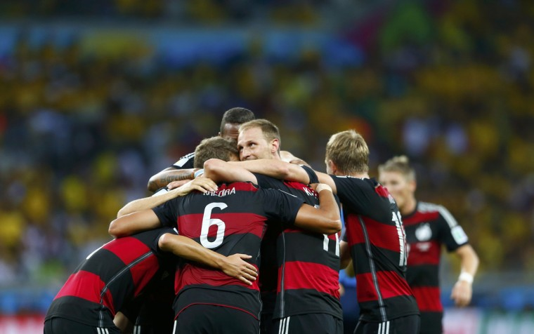 Germany's Sami Khedira (6) celebrates teammates after scoring a goal during the 2014 World Cup semi-finals between Brazil and Germany at the Mineirao stadium in Belo Horizonte July 8, 2014. (Eddie Keogh/Reuters)