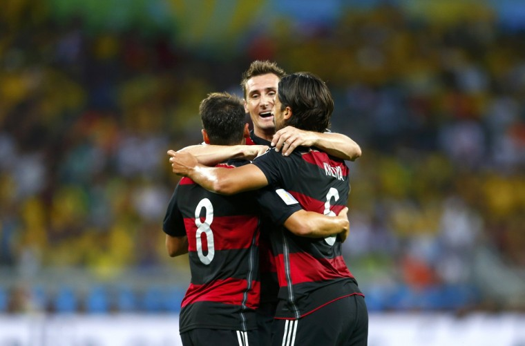 Germany's Sami Khedira (6) celebrates with Miroslav Klose and Mesut Ozil after scoring a goal during the 2014 World Cup semi-finals between Brazil and Germany at the Mineirao stadium in Belo Horizonte July 8, 2014. (Eddie Keogh/Reuters)
