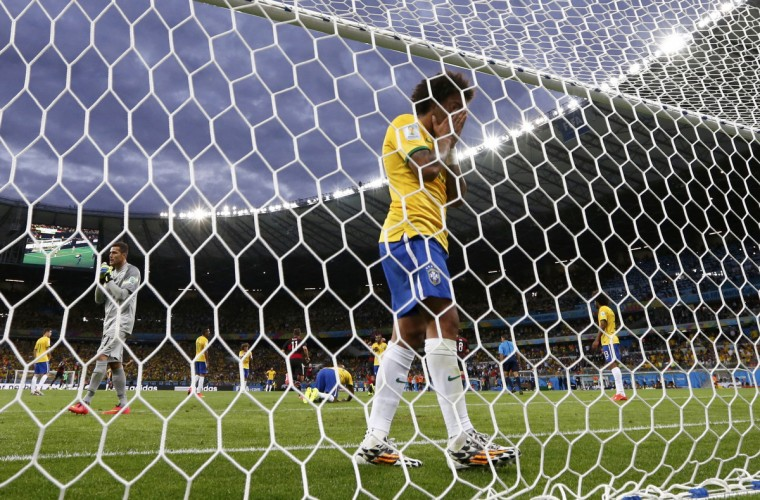 Brazil's Marcelo reacts after Germany scored their fourth goal during their 2014 World Cup semi-finals at the Mineirao stadium in Belo Horizonte July 8, 2014. (Marcos Brindicci/Reuters)