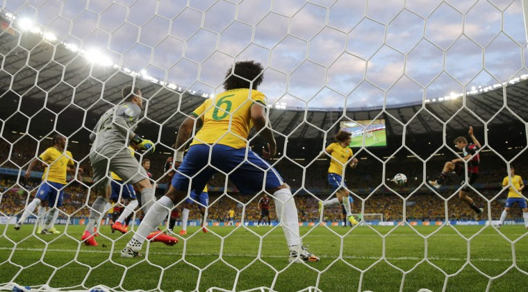 Germany's Miroslav Klose (R) scores his second goal and Germany's fifth during their 2014 World Cup semi-finals against Brazil at the Mineirao stadium in Belo Horizonte July 8, 2014. (Eddie Keogh/Reuters)