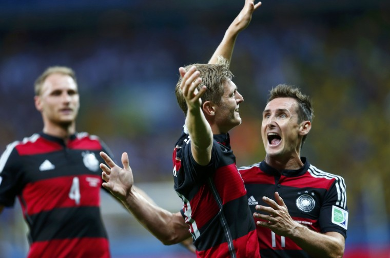Germany's Toni Kroos (C) celebrates his first goal, his team's third, against Brazil with teammates Miroslav Klose (R) and Benedikt Hoewedes during their 2014 World Cup semi-finals at the Mineirao stadium in Belo Horizonte July 8, 2014. (Eddie Keogh/Reuters)