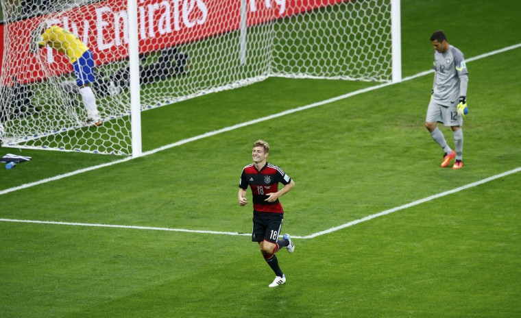 Germany's Toni Kroos celebrates scoring his team's fourth goal against Brazil during their 2014 World Cup semi-finals at the Mineirao stadium in Belo Horizonte July 8, 2014. (Leonhard Foeger/Reuters)