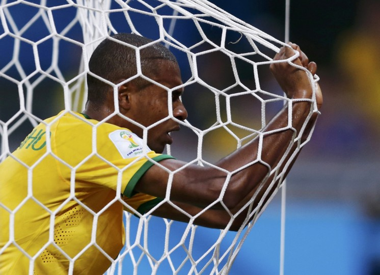 Brazil's Fernandinho reacts in his goal's net after they conceded a goal to Germany during their 2014 World Cup semi-finals at the Mineirao stadium in Belo Horizonte July 8, 2014. (Marcos Brindicci/Reuters)