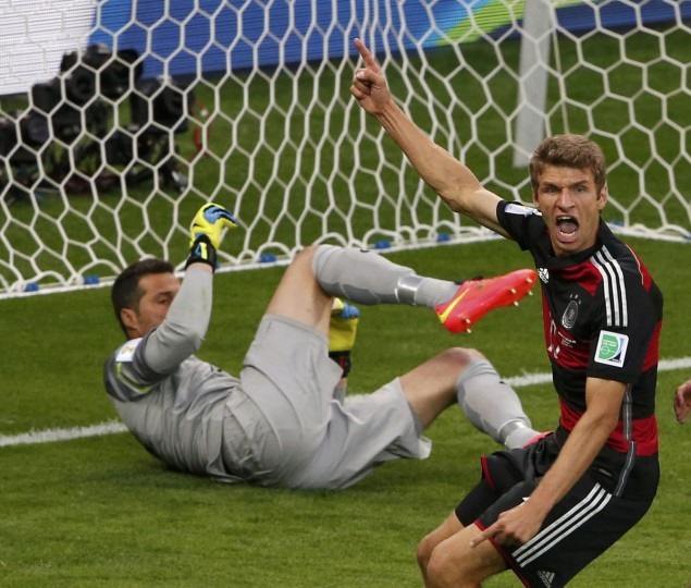 Germany's Thomas Mueller (R) celebrates past Brazil's goalkeeper Julio Cesar after scoring a goal during their 2014 World Cup semi-finals at the Mineirao stadium in Belo Horizonte July 8, 2014. (David Gray/Reuters)