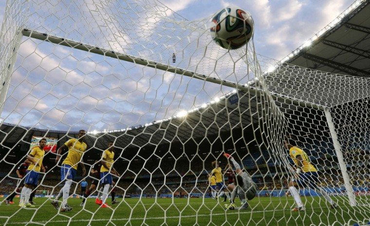 Germany's Thomas Mueller (hidden) scores a goal during their 2014 World Cup semi-finals against Brazil at the Mineirao stadium in Belo Horizonte July 8, 2014. (Marcos Brindicci/Reuters)