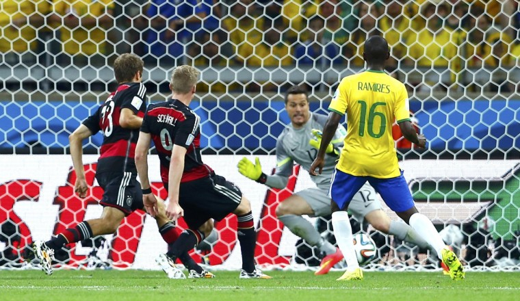 Brazil's Ramires watches as Germany's Andre Schuerrle scores Germany's sixth goal during their 2014 World Cup semi-finals at the Mineirao stadium in Belo Horizonte July 8, 2014. (Eddie Keogh/Reuters)
