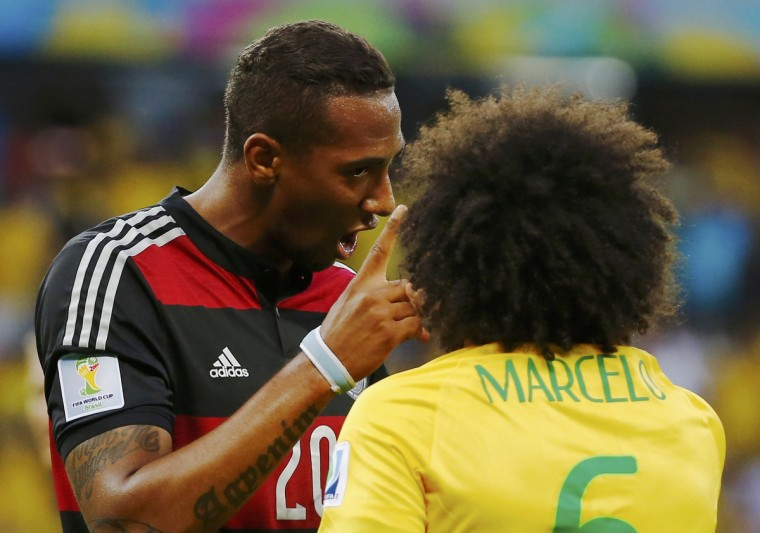 Germany's Jerome Boateng (L) argues with Brazil's Marcelo during their 2014 World Cup semi-finals at the Mineirao stadium in Belo Horizonte July 8, 2014. (Damir Sagolj/Reuters)