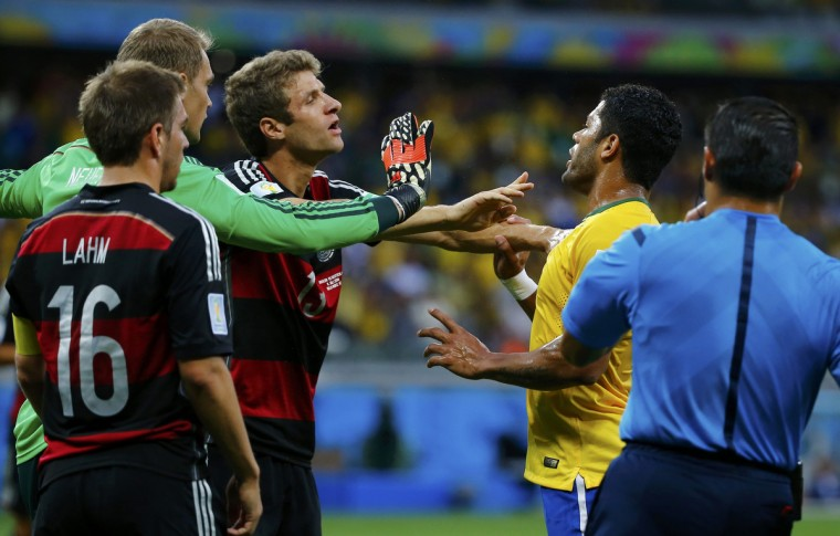 Germany's Thomas Mueller (3rd L) argues with Brazil's Hulk (2nd L) beside teammates Philipp Lahm (L), Manuel Neuer and referee Marco Rodriguez of Mexico (R) during their 2014 World Cup semi-finals at the Mineirao stadium in Belo Horizonte July 8, 2014. (Damir Sagolj/Reuters)