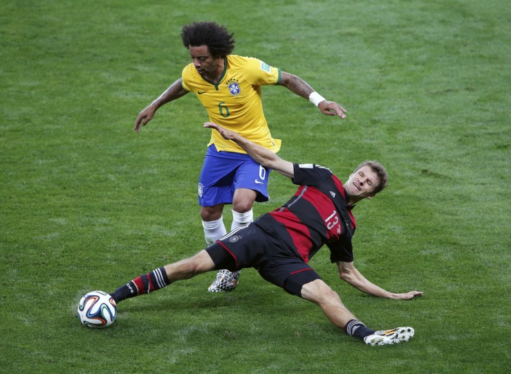 Germany's Thomas Mueller (R) and Brazil's Marcelo fight for the ball during their 2014 World Cup semi-finals at the Mineirao stadium in Belo Horizonte July 8, 2014. (David Gray/Reuters)