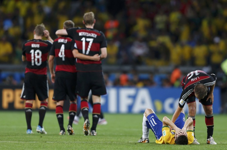 Germany's Philipp Lahm (R) consoles Brazil's Oscar after the 2014 World Cup semi-finals between Brazil and Germany at the Mineirao stadium in Belo Horizonte July 8, 2014. (Marcos Brindicci/Reuters)