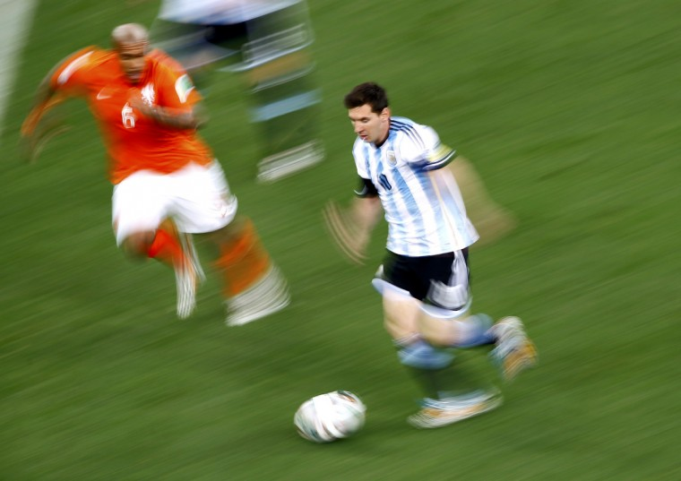 Nigel de Jong of the Netherlands fights for the ball with Argentina's Lionel Messi during their 2014 World Cup semi-finals at the Corinthians arena in Sao Paulo July 9, 2014. (Ricardo Moraes/Reuters)