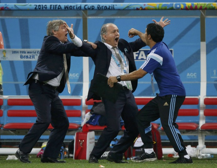 Argentina's coach Alejandro Sabella (C) celebrates after Maxi Rodriguez (not pictured converted the decisive penalty during a penalty shoot-out against the Netherlands at their 2014 World Cup semi-finals at the Corinthians arena in Sao Paulo July 9, 2014. (Sergio Moraes/Reuters)