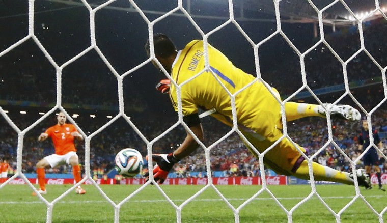 Argentina's Sergio Romero (front) saves the penalty of Ron Vlaar of the Netherlands during their shootout in their 2014 World Cup semi-finals at the Corinthians arena in Sao Paulo July 9, 2014. (Dominic Ebenbichler/Reuters)