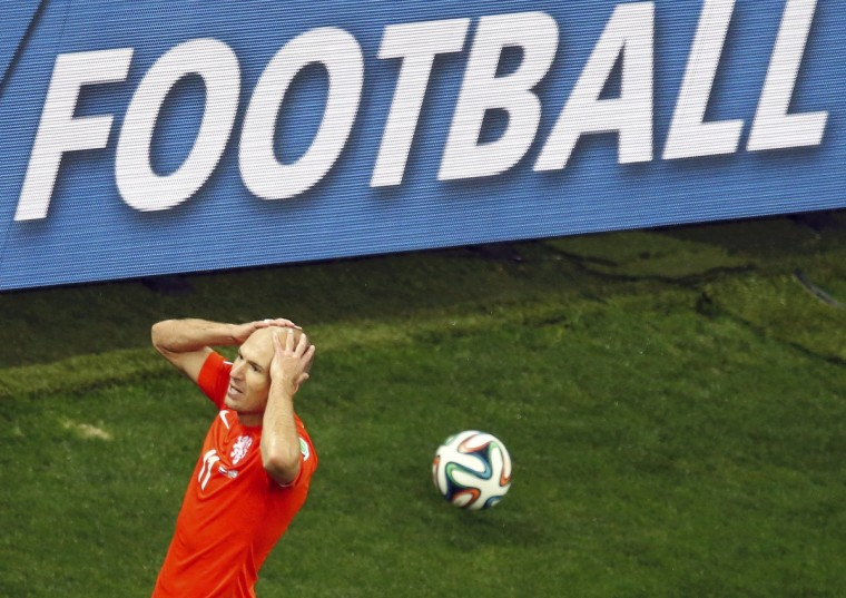 Arjen Robben of the Netherlands reacts after missing a goal opportunity during their 2014 World Cup semi-finals against Argentina at the Corinthians arena in Sao Paulo July 9, 2014. (Paulo Whitaker/Reuters)