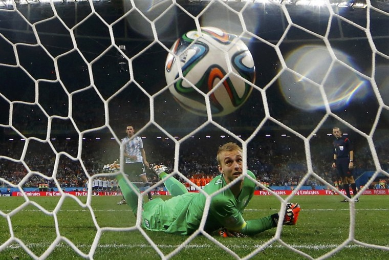 Jasper Cillessen of the Netherlands watches as he fails to stop the decisive penalty shot by Argentina's Maxi Rodriguez during their penalty shootout in their 2014 World Cup semi-finals at the Corinthians arena in Sao Paulo July 9, 2014. (Dominic Ebenbichler/Reuters)
