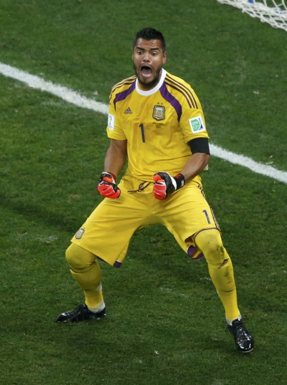 Argentina's goalkeeper Sergio Romero reacts after saving a shot by Ron Vlaar of the Netherlands during a penalty shootout in their 2014 World Cup semi-finals at the Corinthians arena in Sao Paulo July 9, 2014. (Paulo Whitaker/Reuters)