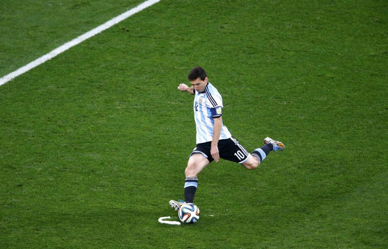Argentina's Lionel Messi takes a free kick during the 2014 World Cup semi-finals between Argentina and the Netherlands at the Corinthians arena in Sao Paulo July 9, 2014. (Ricardo Moraes/Reuters)