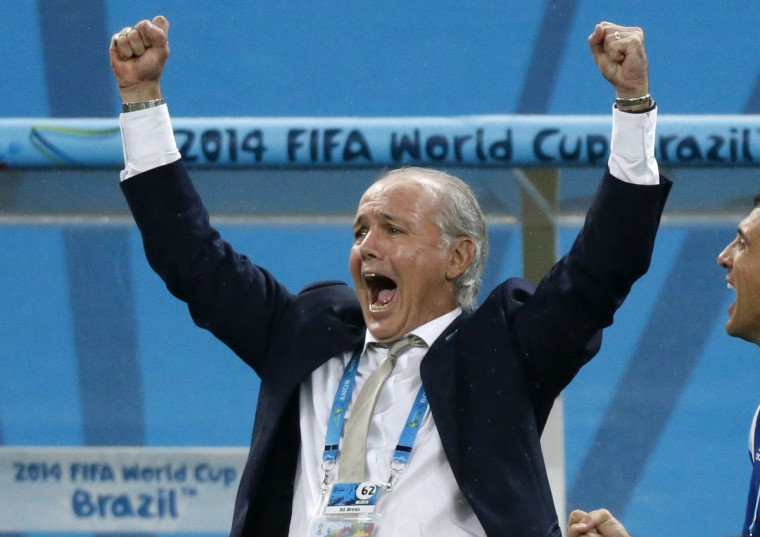 Argentina's coach Alejandro Sabella celebrates after Maxi Rodriguez scores the winning goal during a penalty shootout in their 2014 World Cup semi-finals against Netherlands at the Corinthians arena in Sao Paulo July 9, 2014. (Sergio Moraes/Reuters)