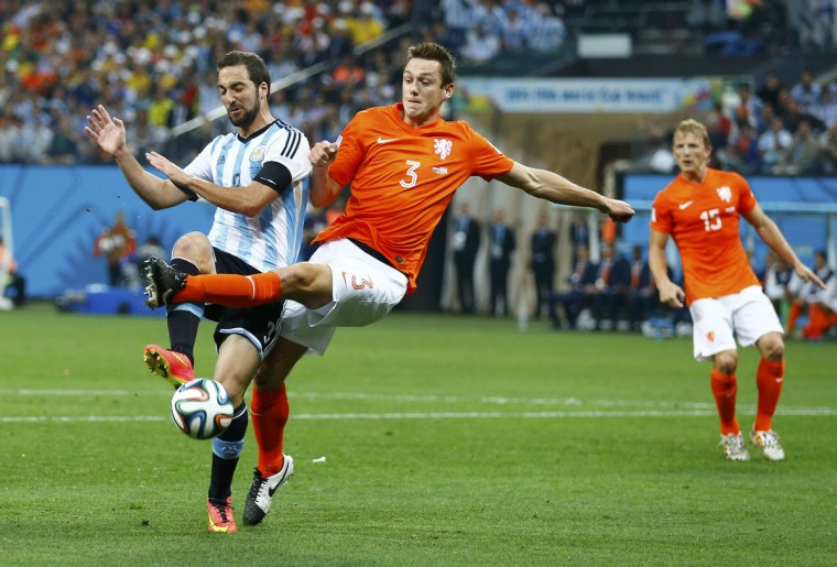 Argentina's Gonzalo Higuain is challenged by Stefan de Vrij of the Netherlands during their 2014 World Cup semi-finals at the Corinthians arena in Sao Paulo July 9, 2014. (Darren Staples/Reuters)