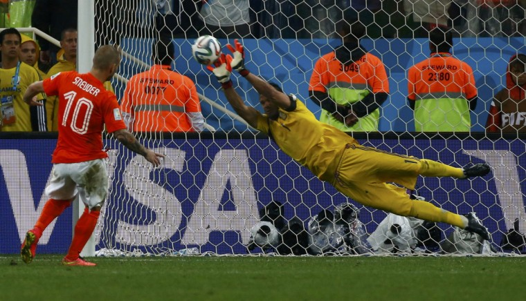 Argentina's goalkeeper Sergio Romero saves the third penalty shot from Wesley Sneijder of the Netherlands during a penalty shootout in their 2014 World Cup semi-finals at the Corinthians arena in Sao Paulo July 9, 2014. (Michael Dalder/Reuters)