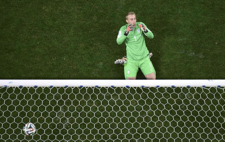 Goalkeeper Jasper Cillessen of the Netherlands reacts after failing to save a penalty goal by Argentina's Maxi Rodriguez during a penalty shootout in their 2014 World Cup semi-finals at the Corinthians arena in Sao Paulo July 9, 2014. (Francois Xavier Marit/Reuters)
