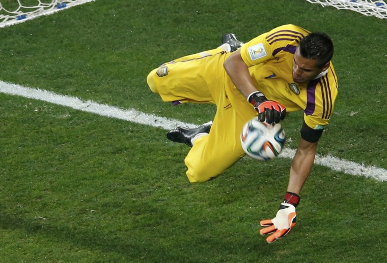 Argentina's goalkeeper Sergio Romero saves a shot by Ron Vlaar of the Netherlands during a penalty shootout in their 2014 World Cup semi-finals at the Corinthians arena in Sao Paulo July 9, 2014. (Paulo Whitaker/Reuters)