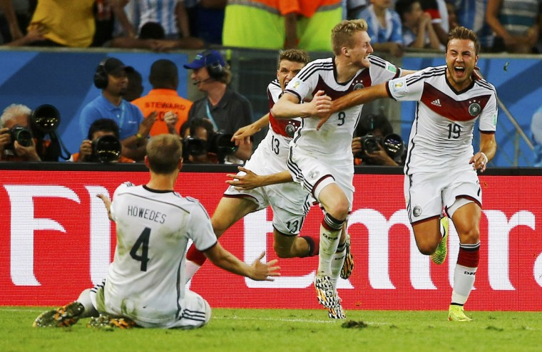 Germany's Mario Goetze (R) celebrates with his teammates after scoring against Argentina during extra time in their 2014 World Cup final at the Maracana stadium in Rio de Janeiro July 13, 2014. (Damir Sagolj/Reuters)